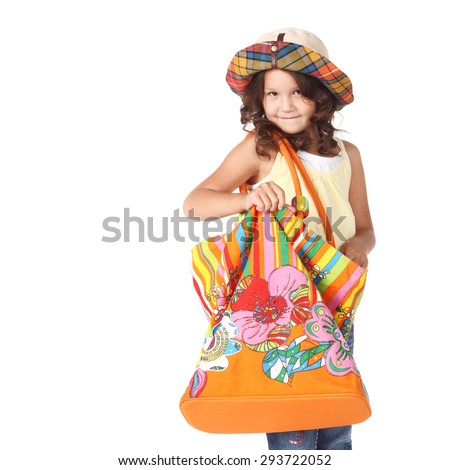 cute little girl in panama with a big bag