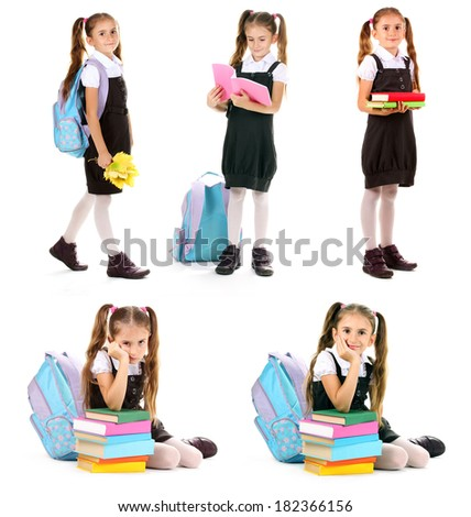 Cute little girl in school uniform isolated on white - stock photo