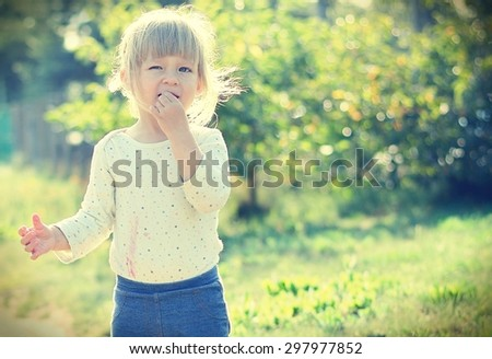 Cute little girl in the sunshine. Back sunlight. MANY OTHER PHOTOS FROM THIS SERIES IN MY PORTFOLIO. - stock photo