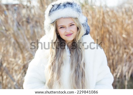 Cute little girl in winter clothes outdoors - stock photo