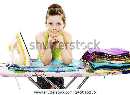Cute little girl ironing clothes. Isolated on a white background  - stock photo