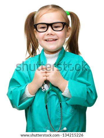 Cute little girl is playing doctor with stethoscope, isolated over white - stock photo