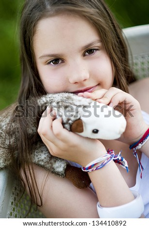 Cute little girl is playing outside in the country - stock photo