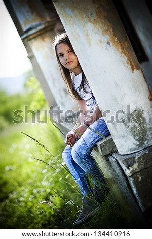Cute little girl is playing outside in the country