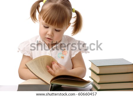 Cute little girl is reading book, back to school, isolated over white