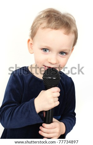 Cute little girl is singing - stock photo