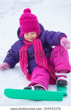 cute little girl is skiing in winter park - stock photo