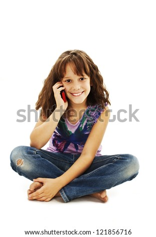 Cute little girl is talking on cell phone.  Isolated on white background. - stock photo