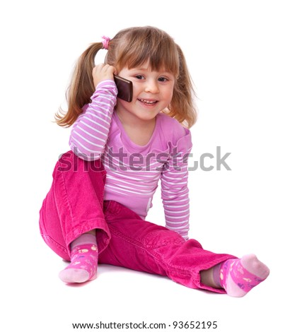 Cute little girl is talking on cell phone, isolated over white - stock photo