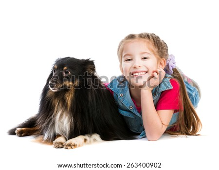 cute little girl is with her dog Sheltie on white