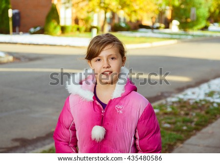 Cute little girl jacket playing in beautiful on sunny fall day - stock photo