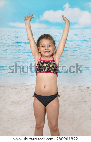 Cute little girl jumps on beach - summer, sun, sea, vacation, childhood concept - stock photo