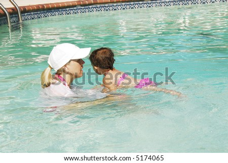 Cute little girl learning to swim. - stock photo