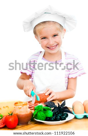cute little girl little girl cuting sausage on a white - stock photo