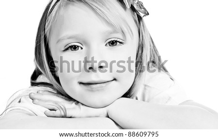 cute little girl looks into the camera - stock photo