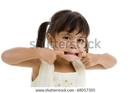 cute little girl making a grimace, isolated on white background