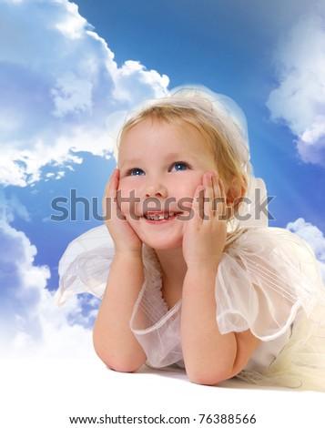 cute little girl on sky - stock photo