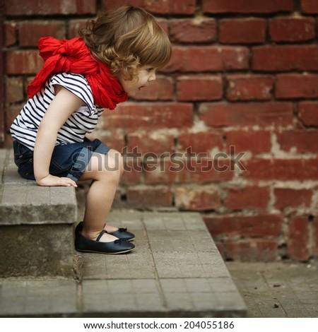 cute little girl on stairway - stock photo