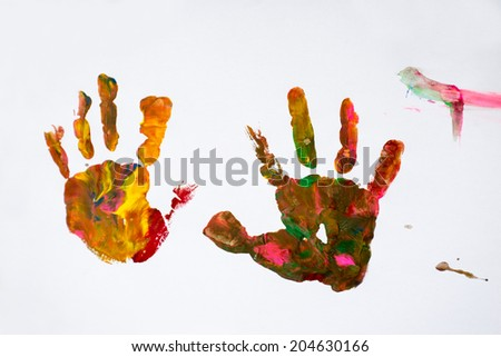 Cute little girl on the paper printed fingerprints - stock photo