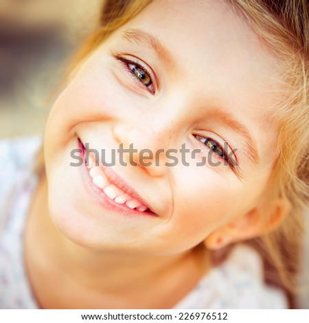 Cute little girl on the wood in spring day - stock photo