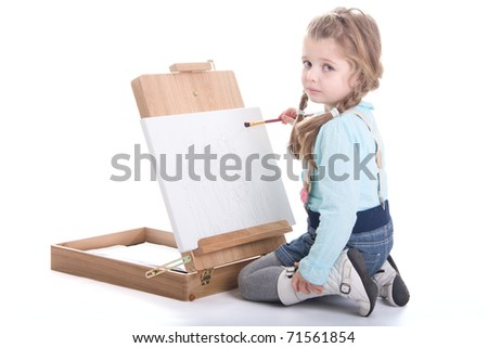 Cute little girl paints, isolated on white background, small artist - stock photo