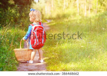 cute little girl picking mushrooms in summer forest - stock photo