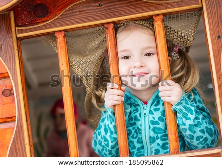 cute little girl playing at the playground - stock photo