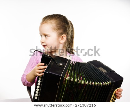 Cute little girl playing harmonica, isolated on white, music education concept - stock photo