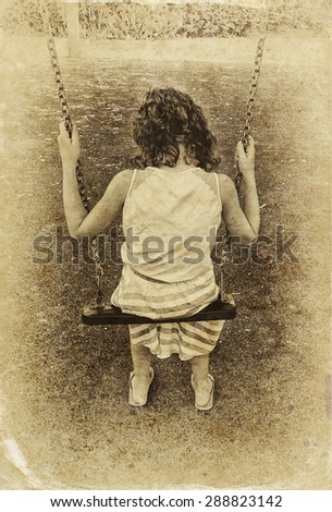 cute little girl playing in the garden Swinging on a swing. filtered image, old style photo