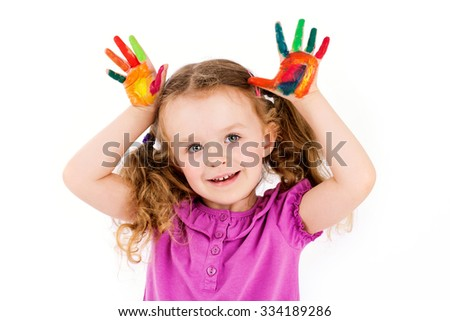Cute little girl playing with watercolors - stock photo