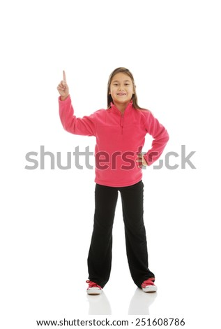 Cute little girl pointing up - stock photo