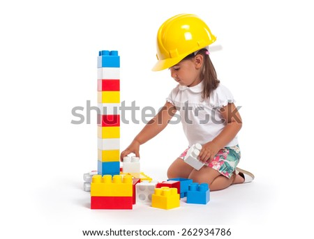 Cute little girl portrait playing with blocks - stock photo