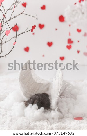 Cute little girl, posing for Valentines day, hearts and decoration, angel - stock photo