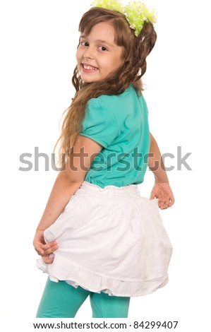 cute little girl posing on a white