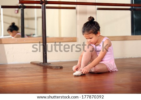 Cute little girl practicing her ballet - stock photo