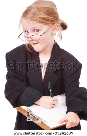 Cute little girl pretending to be a business woman - stock photo