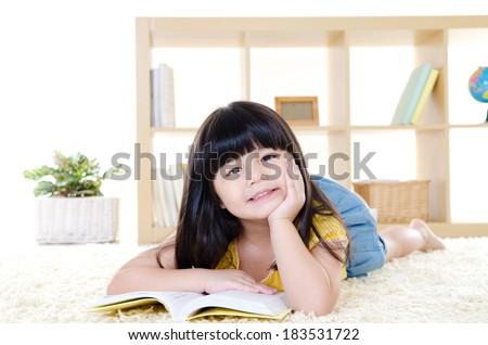 Cute little girl reading - stock photo