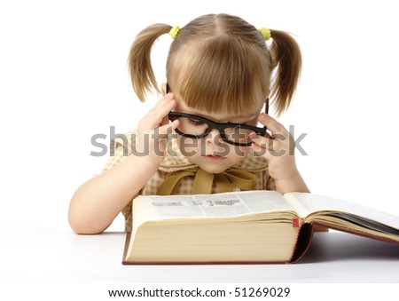 Cute little girl reading big book, back to school, isolated over white - stock photo