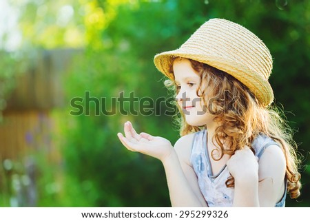 Cute little girl  showing or present empty open hand palm. Advancing concept. - stock photo