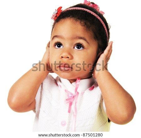 Cute little girl shutting dawn her ears, white background - stock photo