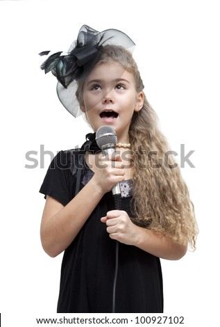 Cute little girl singing into a microphone on a white background - stock photo