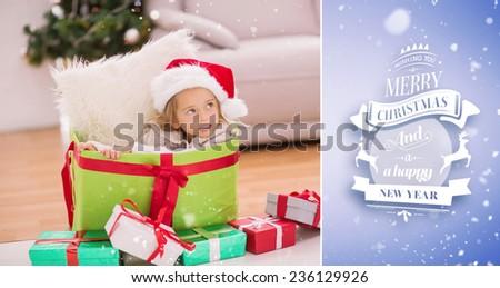 Cute little girl sitting in giant christmas gift against purple vignette - stock photo