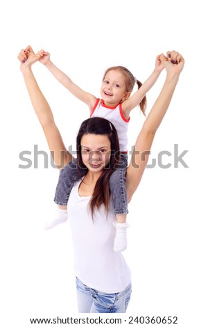 cute little girl sitting on her mothers back