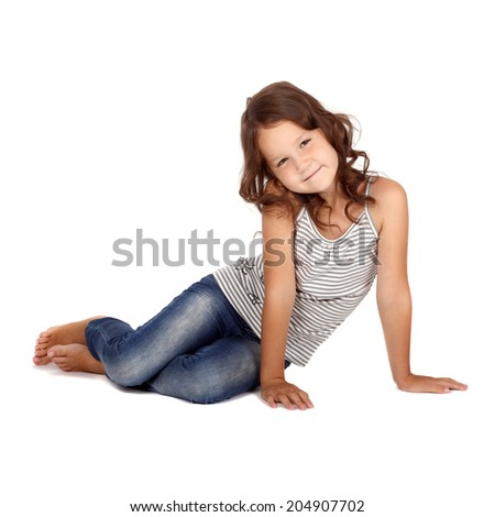cute little girl sitting on the floor