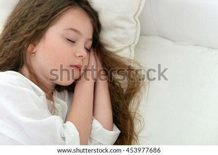 Cute little girl sleeping - stock photo