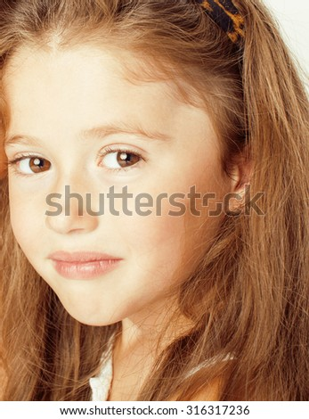 cute little girl smiling isolated on white background close up