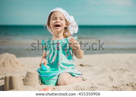 cute little girl smiling on the beach