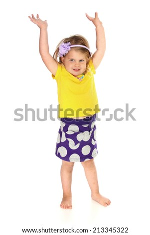 Cute little girl standing on a white background - stock photo