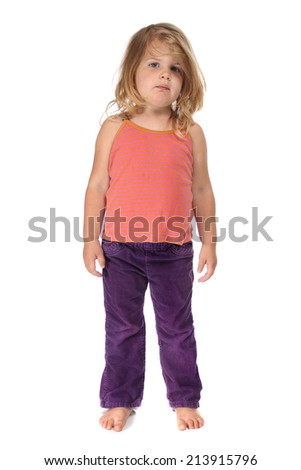 Cute little girl standing on a white background