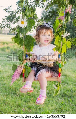 Cute little girl  swinging at park  - stock photo